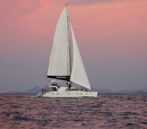 As the sun sets, enjoy the thrill of pure sailing on Sailaway V, a luxury Lagoon 500 sailing catamaran