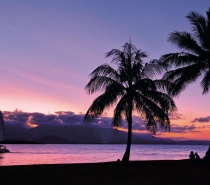 Soak up the peace and tranquillity of a tropical sunset over the Coral Sea as you sail along the coast off Port Douglas.
